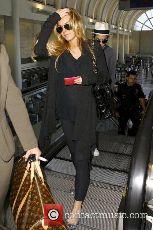 Arrive at LAX airport to catch a flight
