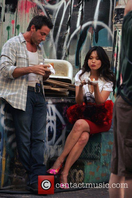 Eats a hot dog while filming a scene...