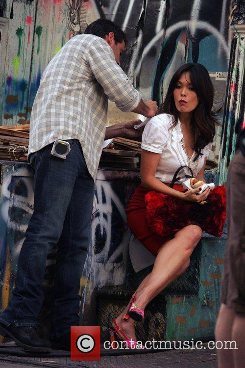 Lindsay Price eats a hot dog while filming...