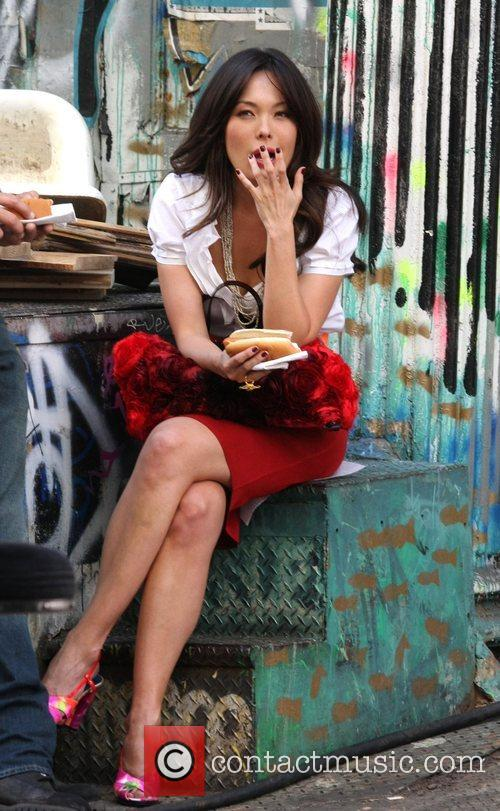 Lindsay Price eat a hot dogs while filming...