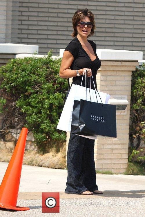 Lisa Rinna carrying large shopping bags outside Barneys...