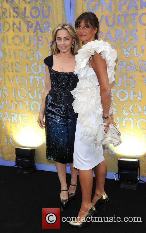 Jeanne Marine (L) and guest Louis Vuitton hosts...