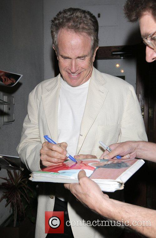 Warren Beatty signs autographs as he leaves Madeo...