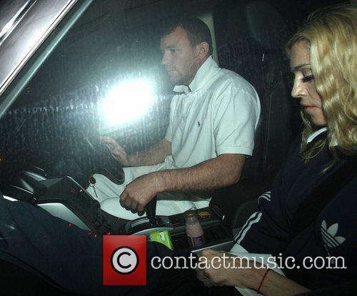 Madonna and husband Guy Ritchie leaving the Kabbalah...
