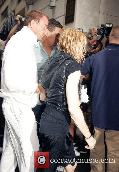Guy Ritchie and Madonna arriving at the Kabbalah...