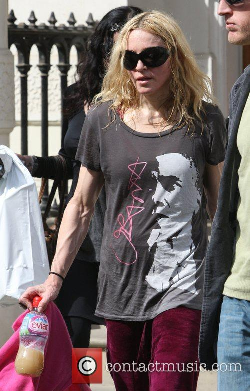 Madonna leaving her gym looking very veiny and...