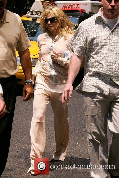 Madonna goes for a walk on the streets...