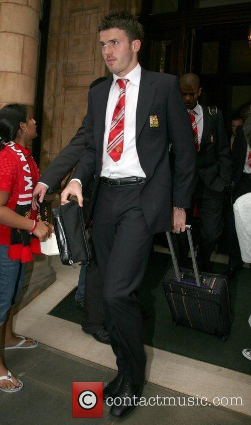 Manchester United football team leaving The Landmark Hotel...