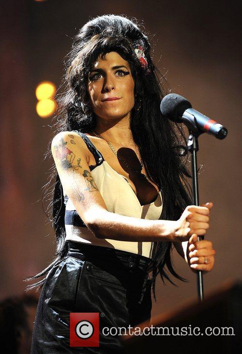 Amy Winehouse and Nelson Mandela 12