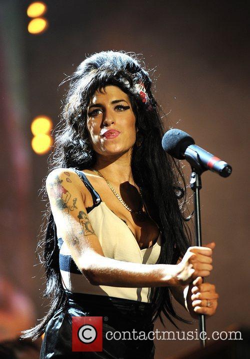 Amy Winehouse and Nelson Mandela 14