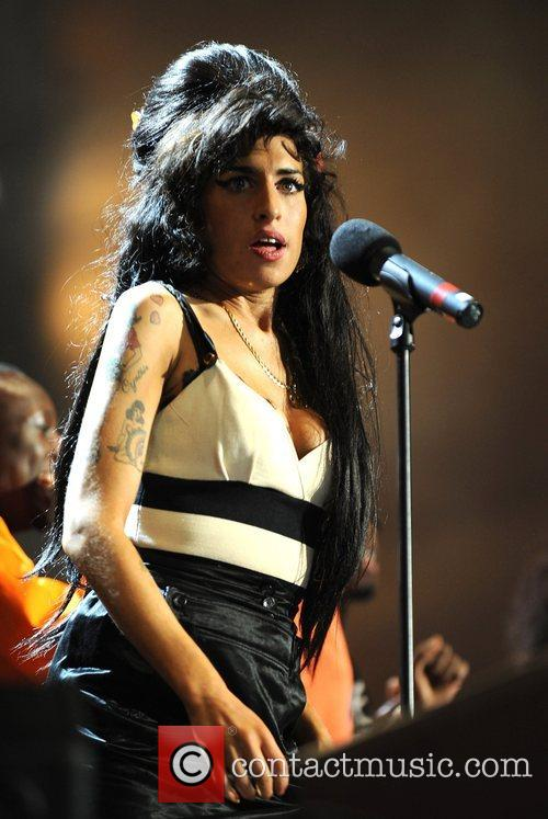 Amy Winehouse and Nelson Mandela 1