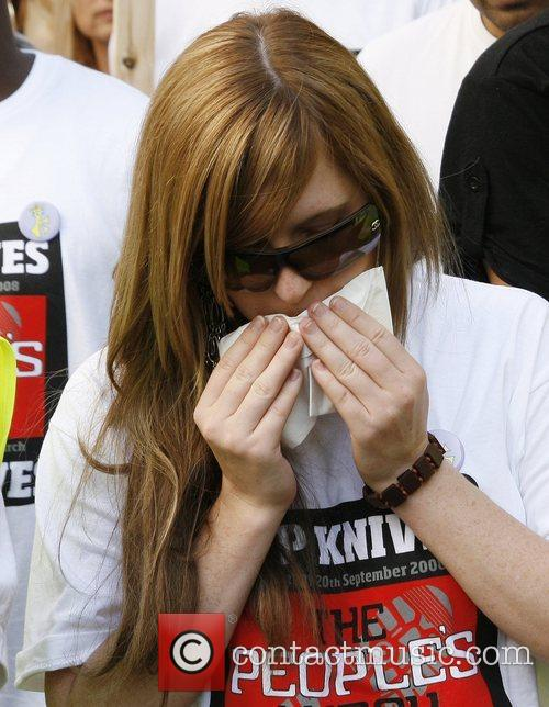 Brooke Kinsella weeps following a march to demonstrate...