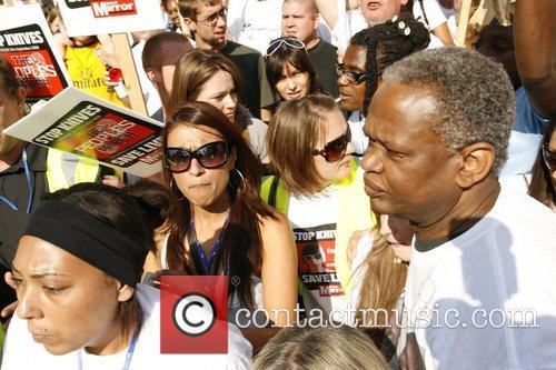 Damilola Taylor's father Richard marching to demonstrate participants...