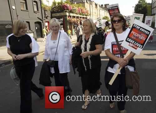 Linda Robson and friends following a march to...