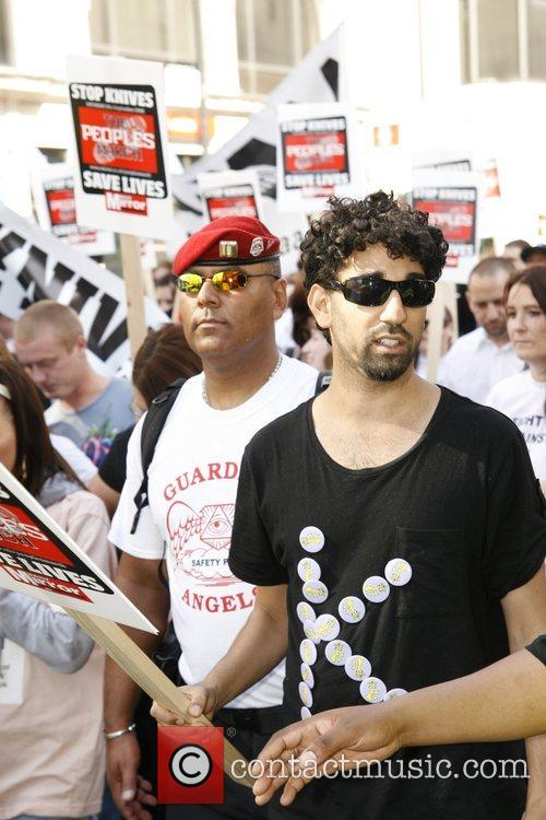 Ray Panthaki marching to demonstrate participants commitment to...