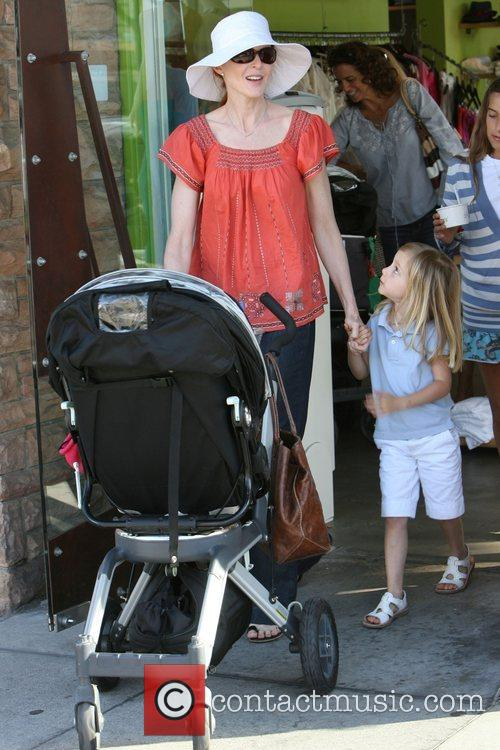 Marcia Cross shopping with her twin daughters, Eden...