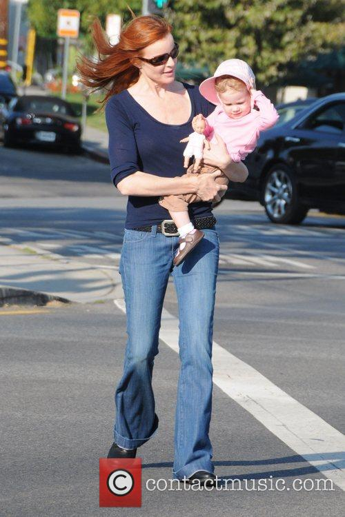 Having a stroll with her daughter in Brentwood