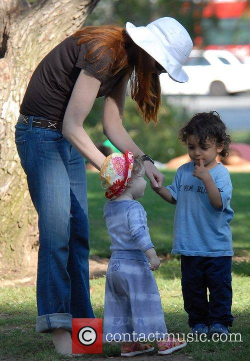 Marcia Cross takes her daughter to the park...