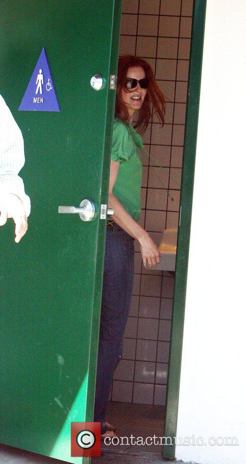 Marcia Cross using the mens bathroom at Malibu...