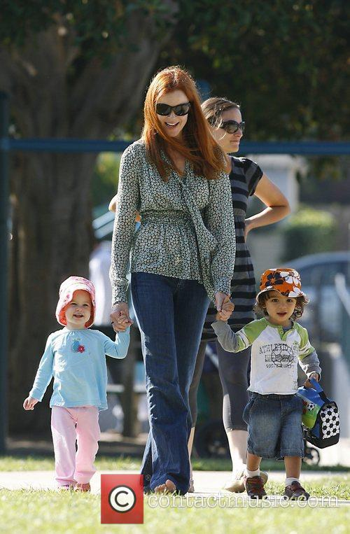 Marcia Cross plays with her children in a...