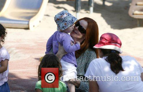 Plays with her children in a park in...