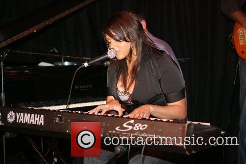 Marsha Ambrosius performing at The Eclectic Ride and...