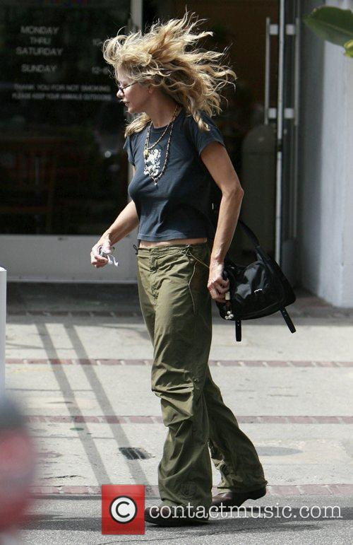 Meg Ryan and her son  shop at...
