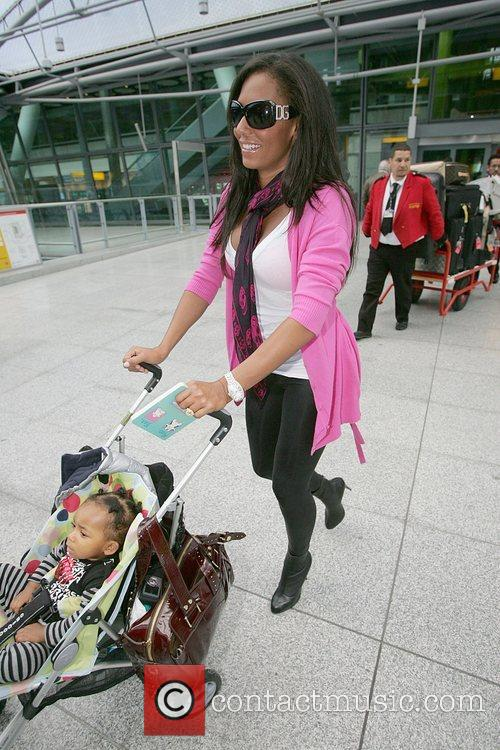 Melanie Brown arrives at Heathrow airport with her...