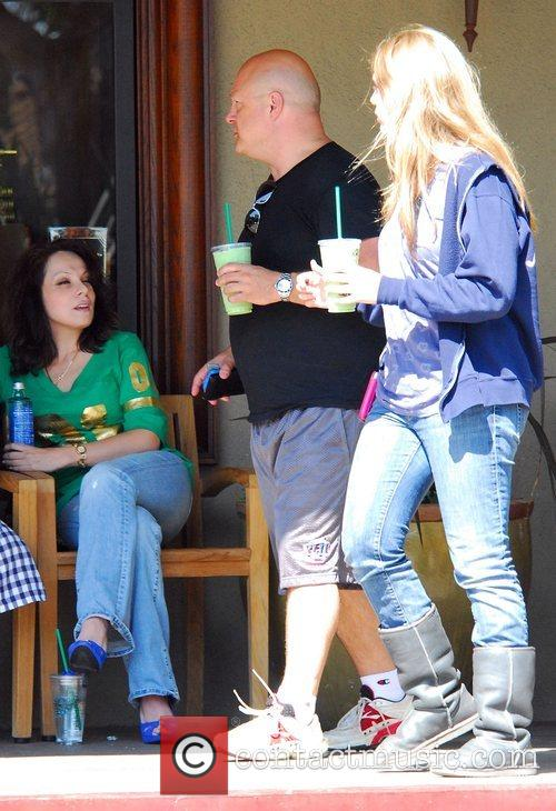 Picks up some Starbucks with his daughter