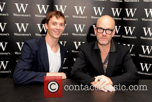 Signing their new book 'Hello' at Waterstone's in...