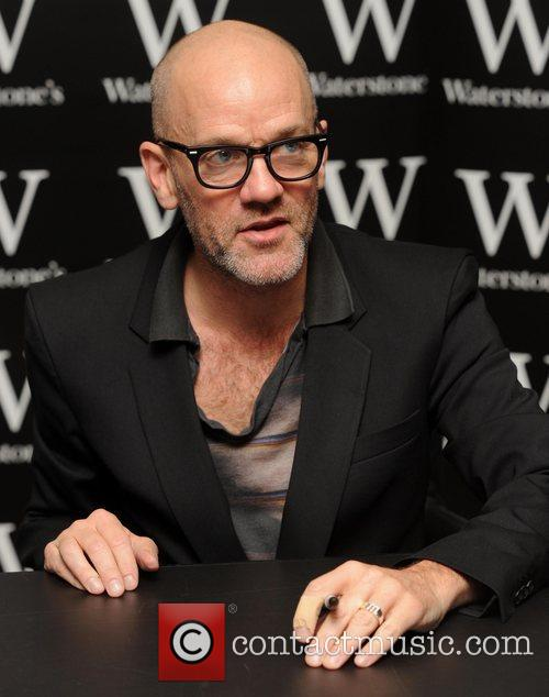 Michael Stipe of R.E.M signing their new book...