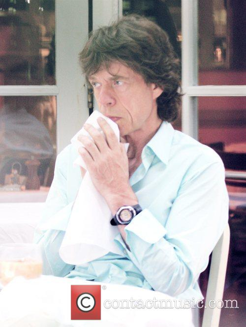 Mick Jagger eating at Orso restaurant in Beverly...