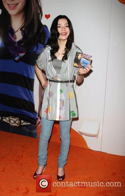 Tween star promoting her show's album 'iCarly iPlaylist'...