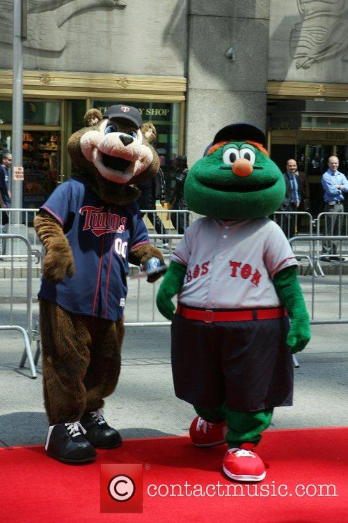 Twins' mascot ' T.C. Bear' and Boston Red...