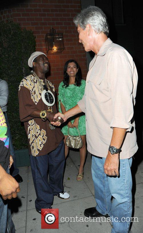 Flavor Flav greets Michael Buffer and his new...