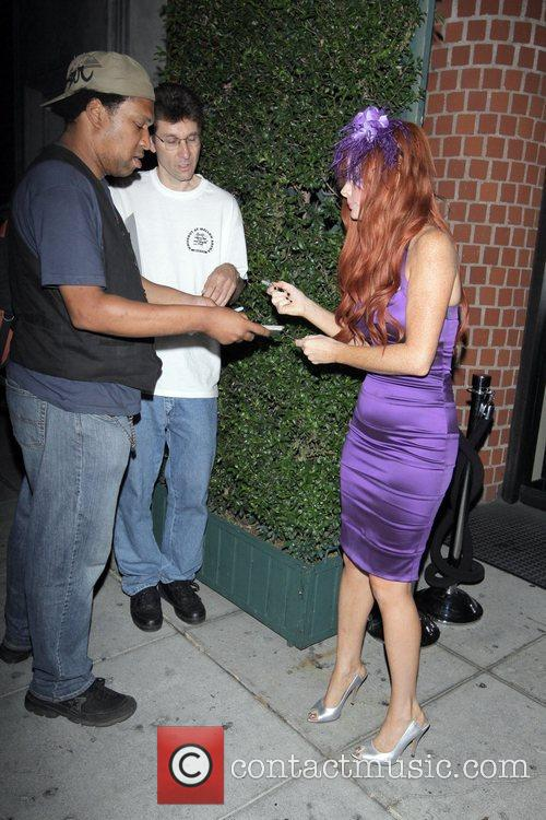 Phoebe Price signs autographs outside Mr Chow restaurant...