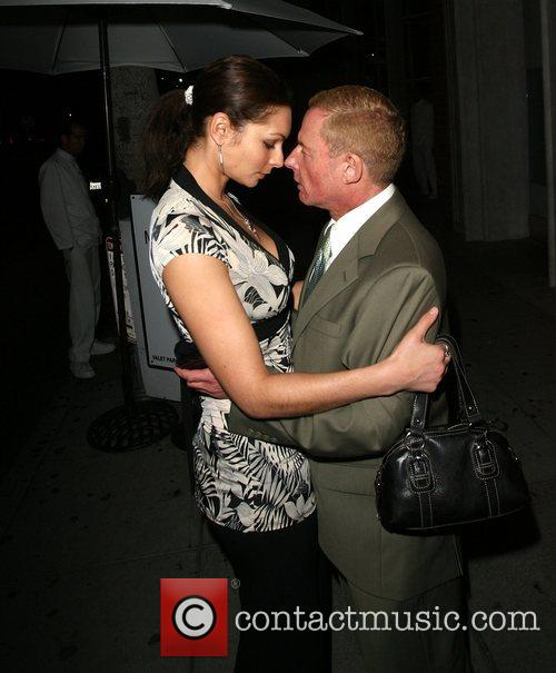 Publicist Elliot Mintz with a mystery woman at...