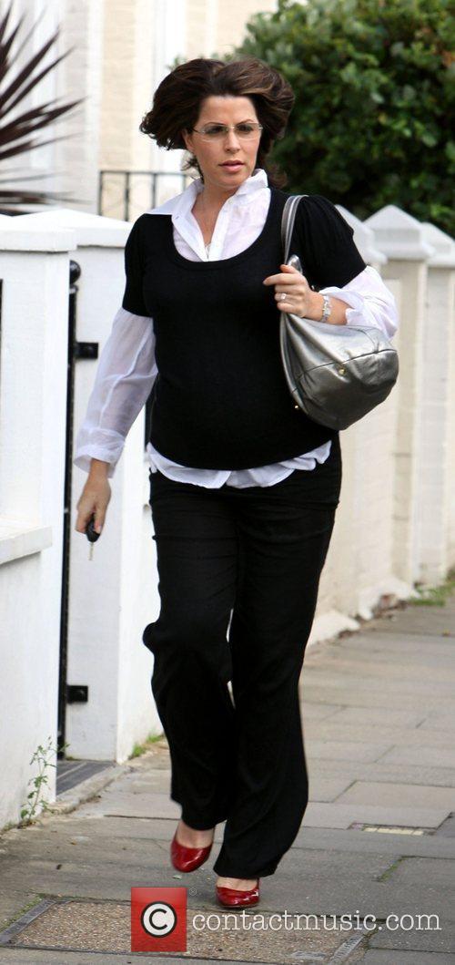 A heavily pregnant Natasha Kaplinsky looking windswept as...