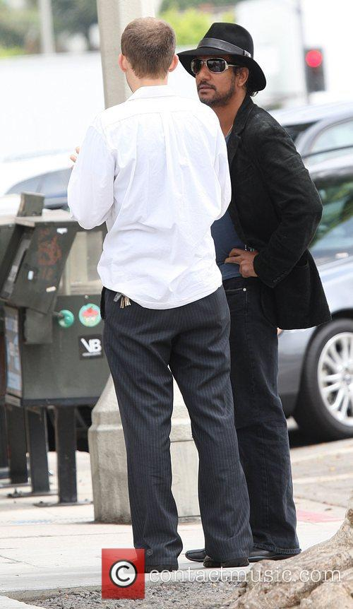 Naveen Andrews talking with a friend Los Angeles,...