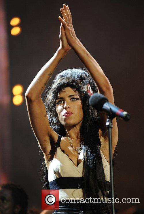 Amy Winehouse and Nelson Mandela 1