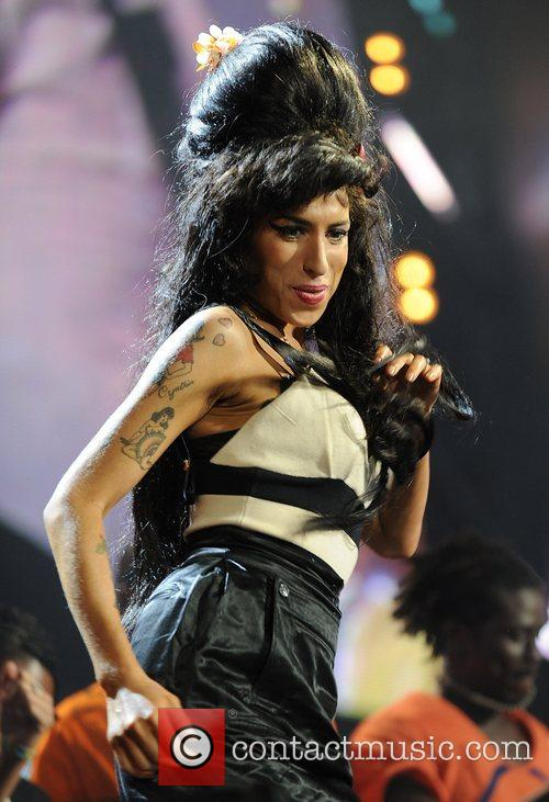 Amy Winehouse and Nelson Mandela 6