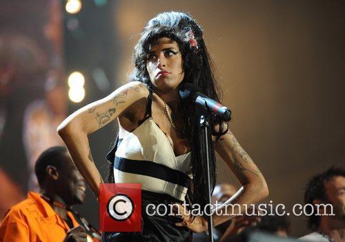 Amy Winehouse and Nelson Mandela 3