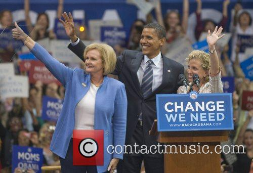 Wave to the supporters at the Barack Obama...