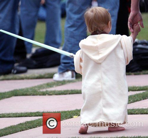 Baby 'Yoda' with a lightsaber Thousands of comic...