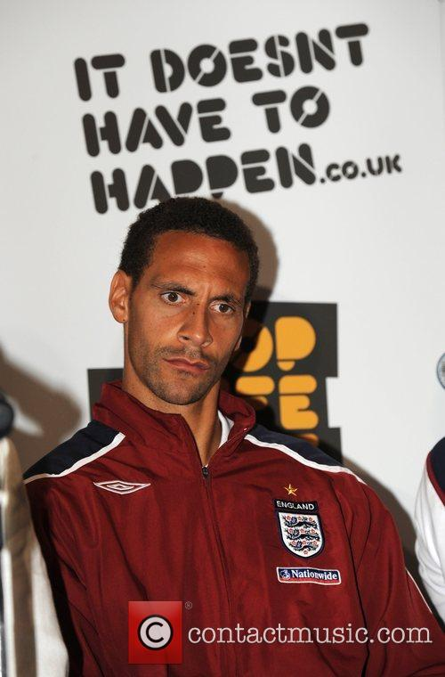 Rio Ferdinand and players from the England football...
