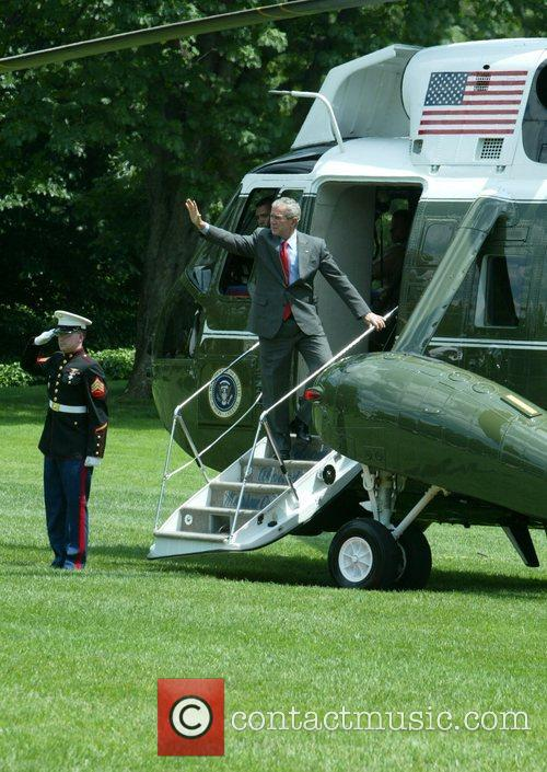 US President George W. Bush departed the Oval...
