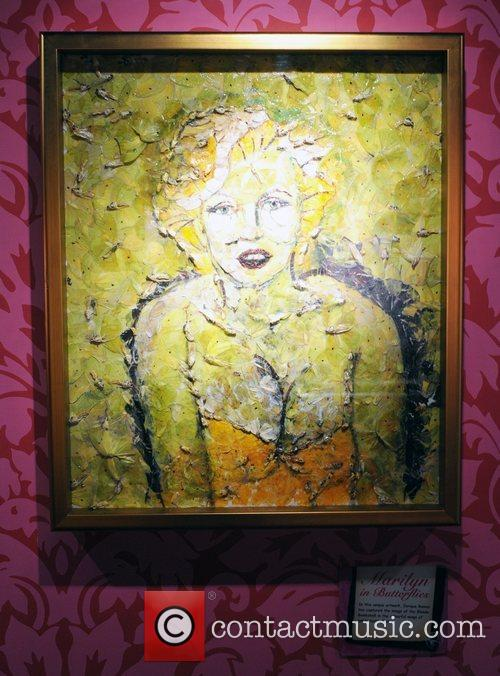 Marilyn Monroe artwork made of wings of jungle...