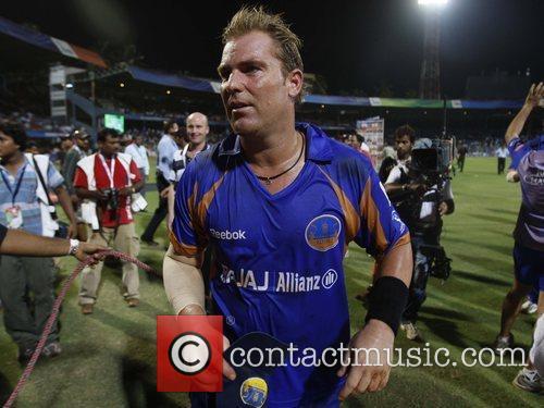 Shane Warne  player of Rajasthan Royals walks...