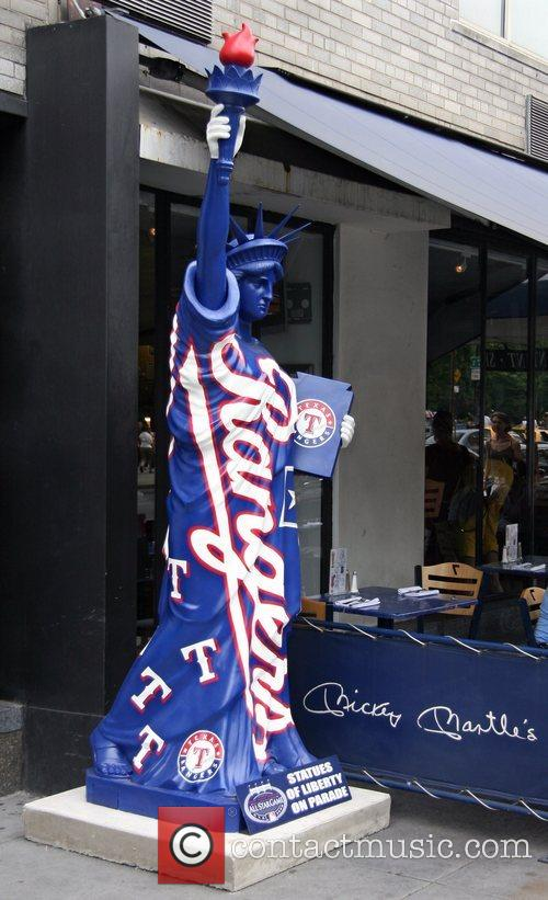Baseball-themed replicas of the Statue of Liberty are...