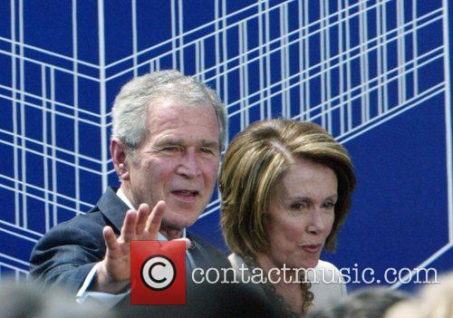 President George Bush and Nancy Pelosi attend the...